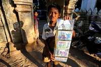 Bagan boy selling self made post cards