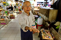 Yangon man selling home made spinning tops